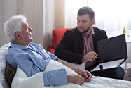Estate Representative reviewing documents with older man