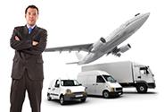 Confident man overseeing a fleet of vehicles